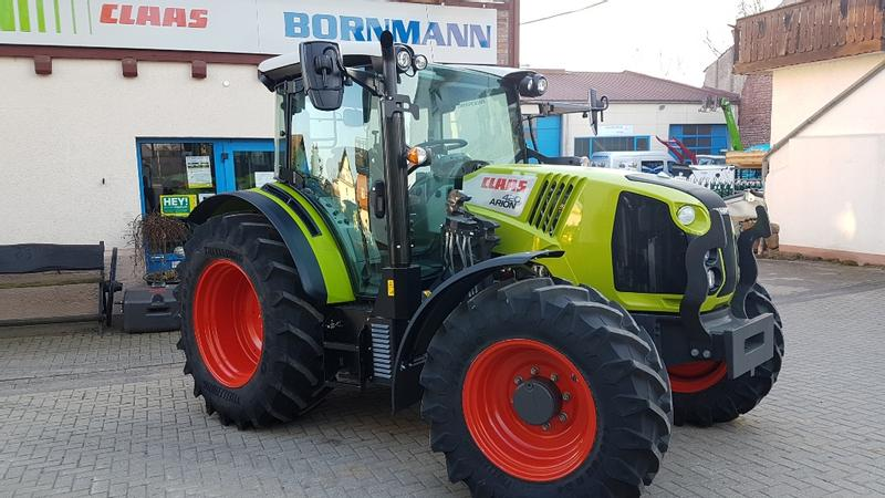 Claas Arion 420 CIS mit Frontladerkonsole